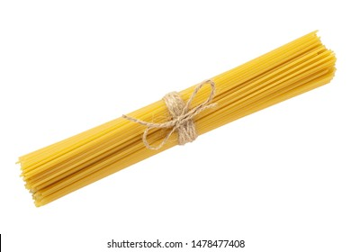Raw dry spaghetti tied with brown twine on white background isolated