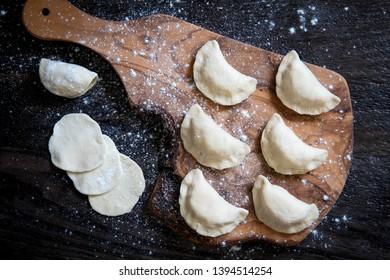 Raw dumpling with potatoes. Preparation dumplings on a wooden board.