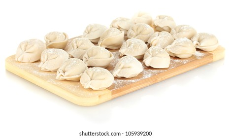 Raw Dumplings on cutting board isolated on white