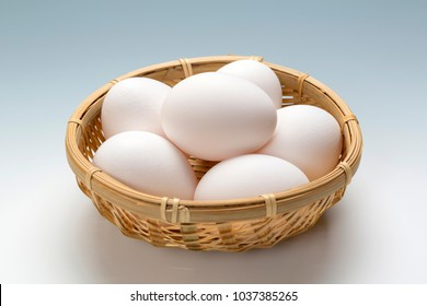 Raw egg in bamboo cage.