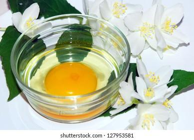 Raw egg yolk in a glass bowl