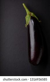Raw eggplant on black