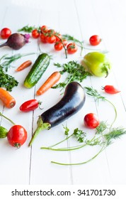 Raw eggplant with vegetables on white table, selective focus