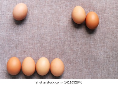 Raw eggs on brown background, Seven Raw eggs on brown background
