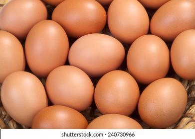 Raw eggs on straw tray
