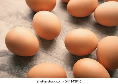 Raw eggs on wooden background