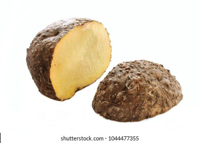 Raw Elephant Yam cut in half / Suran (Chena) isolated on white , selective focus