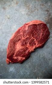 Raw entrecote steak on table