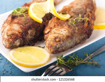 Raw European carp with a thyme and lemon, living fish