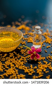 Raw fenugreek seeds on the wooden surface with some coconut oil and its paste in a glass bowl used as the remedy of dandruff.Famous natural method.