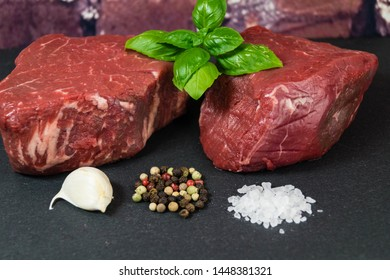 raw filet Steak with spices and vegetables
