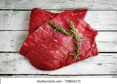 raw fillet of beef brisket on white wooden background