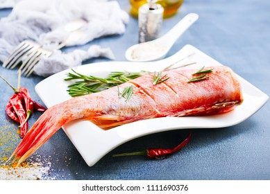 raw fish with aroma spice and salt, ocean perch on white plate