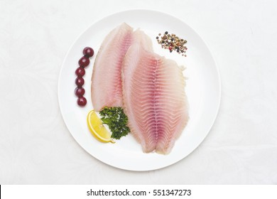 raw fish fillet white plate isolated