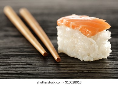 raw fish on white rice and black table
