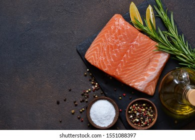 Raw fish salmon filet prepared for cooking. View from above.