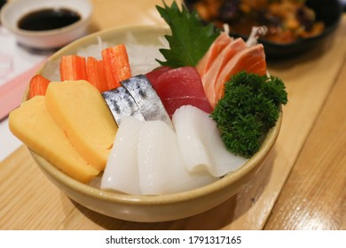 Raw fish slices Japanese style on bowl