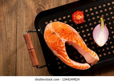 Raw fish steak above