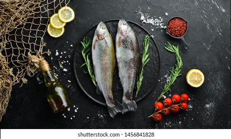 Raw fish trout on a plate. Top view. Free space for your text.