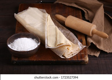 raw flaky homemade dough on the table