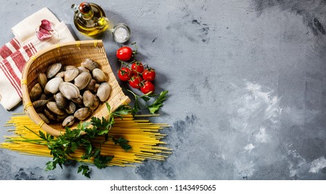 Raw food Ingredients for cooking Spaghetti alle Vongole on concrete background copy space