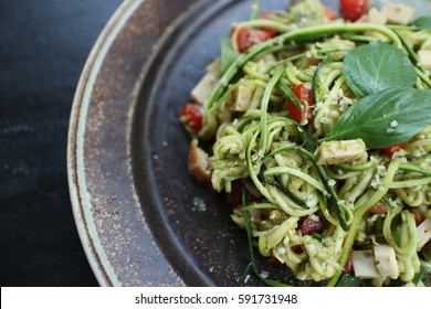 Raw food. Zoodles (Zucchini Noodles) with Basil Pesto.