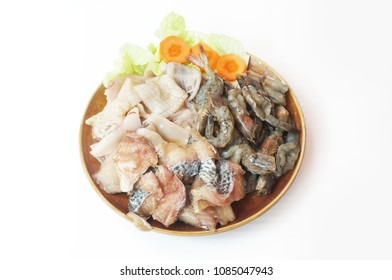 Raw foods: Fresh squid, white leg shrimp or pacific white shrimp (Litopenaeus vannamei, formerly Penaeus vannamei) and fish with chinese cabbage isolated on white background, close up