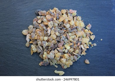 Raw Frank Incense tears (olibanum gummi from Somalia), from the first harvest, with barks and all grades, on a slate stone background