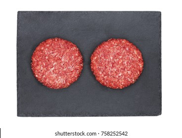 Raw fresh beef burgers on stone plate on white background