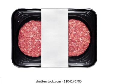 Raw fresh beef burgers in plastic tray on white background with silver label