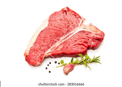 Raw fresh beef T-bone steak and seasoning isolated on white background