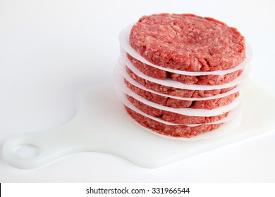 Raw fresh burger patties ready for cooking