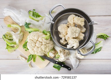 Raw and fresh cauliflower on the table of the kitchen to be cooked