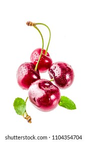 Raw fresh cherry with water drops, simple pattern isolated on white background