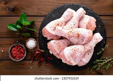 Raw fresh chicken legs on wooden background. Top view