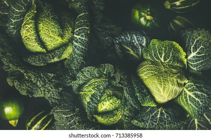 Raw fresh green cabbage texture and background, top view over dark background, selective focus