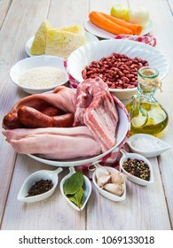 Raw and fresh ingredients for cooking a traditional Portuguese feijoada