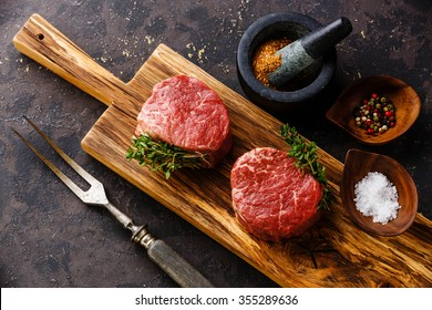 Raw fresh marbled meat Steak filet mignon and seasonings on black background