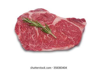 Raw fresh meat ribeye steak on white background