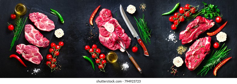 Raw fresh meat steak with cherry tomatoes, hot pepper, garlic, oil and herbs on dark stone, concrete background. Banner