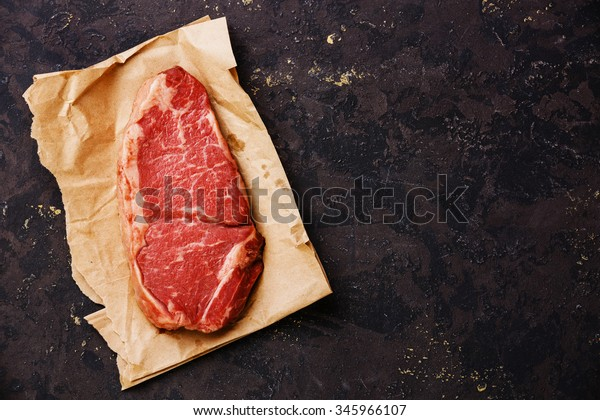 Raw fresh meat Striploin steak on kraft paper background