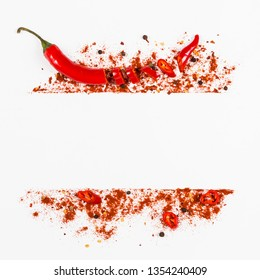 Raw fresh organic, red pepper flakes and dried ground chili pepper with sliced. Assorted pepper spices on white background. Seasonings for food frame. Homemade spices ingredients for cooking.