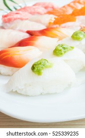 Raw fresh salmon , fish , shrimp , and more Sushi in white plate - Japanese food style