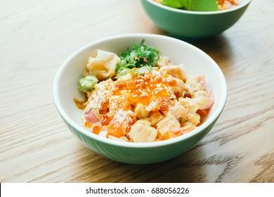 Raw fresh sashimi fish meat in rice bowl - Japanese food style
