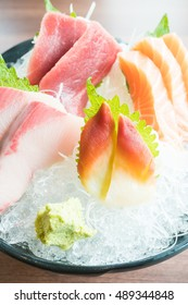 Raw fresh sashimi with salmon , tuna , and other fish - Japanese food style