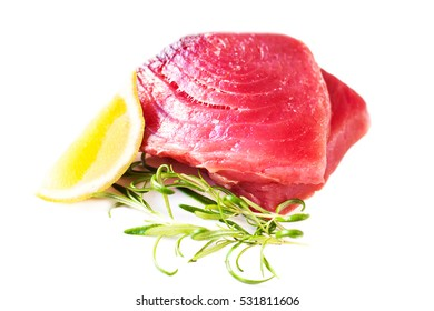 Raw fresh tuna fillet isolated on white background closeup, macro