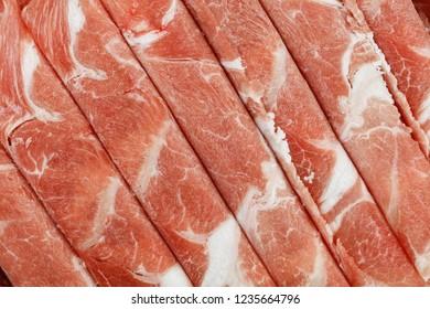 Raw freshly prepared sliced lamb for hot pot.