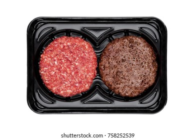 Raw and fried fresh beef burgers in plastic tray on white background
