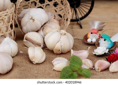 Raw garlic has health benefits on wood background