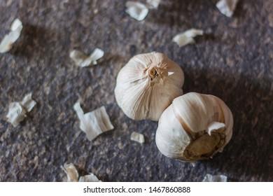 Raw garlic on a stone table